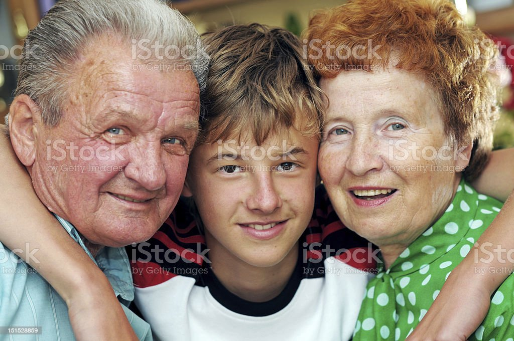 Grandparents with grandson royalty-free stock photo