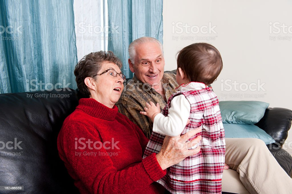 Grandparents with their granddaughter royalty-free stock photo