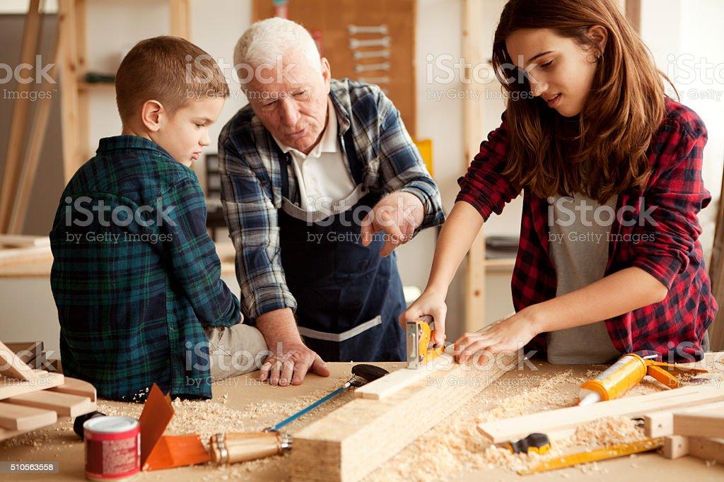 Grandpa's little heplpers stock photo