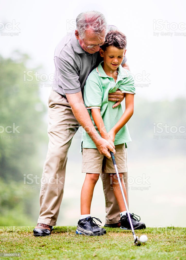 Grandson and Grandfather Playing Golf stock photo