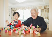 Grandson and grandma playing with blocks
