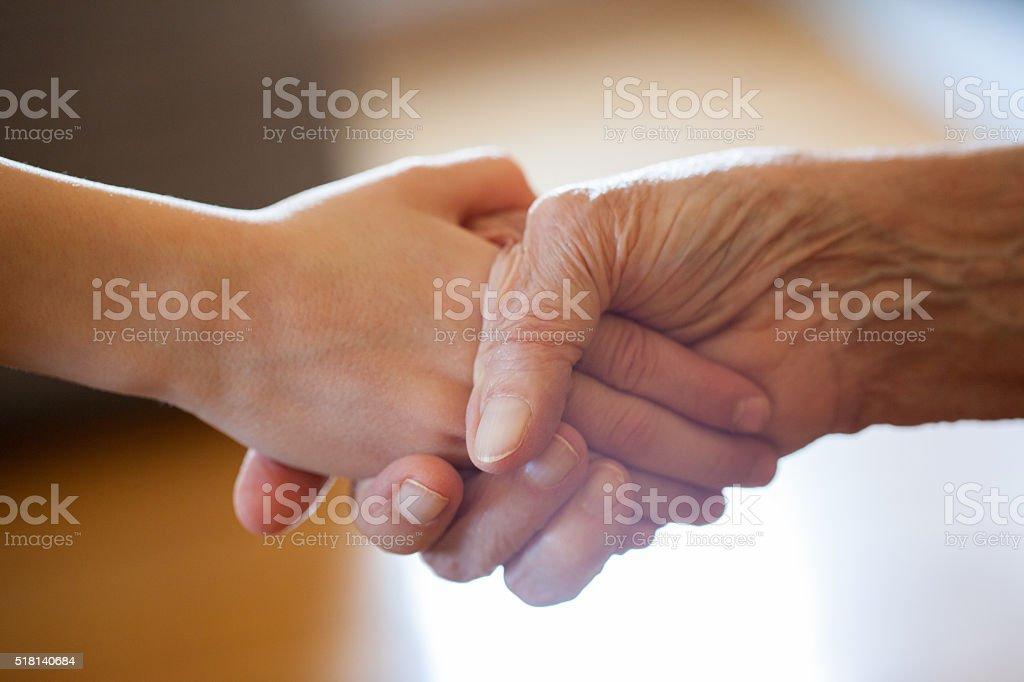 Grandson and granny handshake stock photo