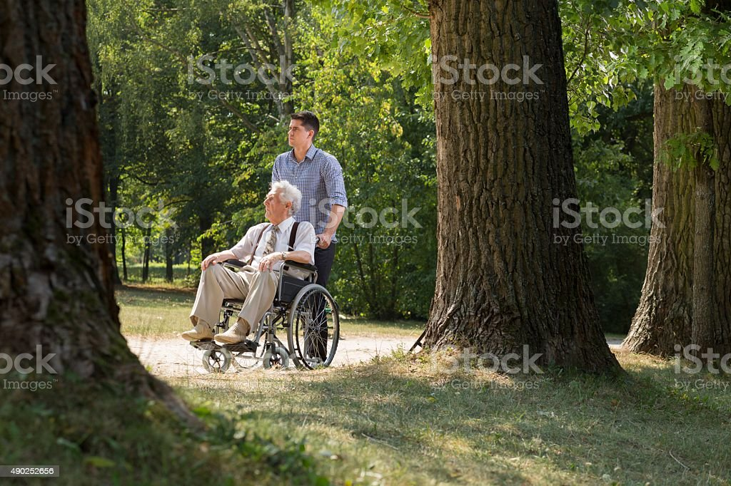 Grandson enjoying day with grandfather stock photo