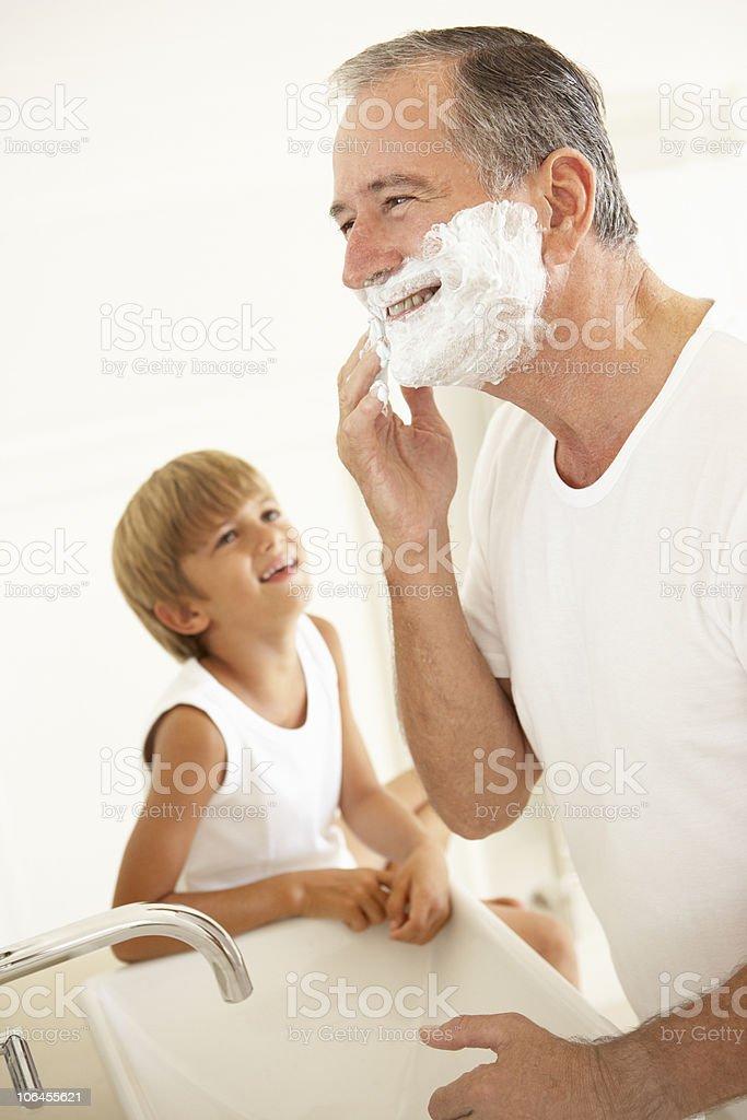 Grandson Watching Grandfather Shaving royalty-free stock photo