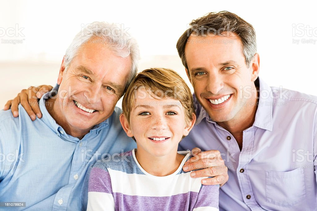 Grandson With Grandfather And Father Smiling Together At Home royalty-free stock photo