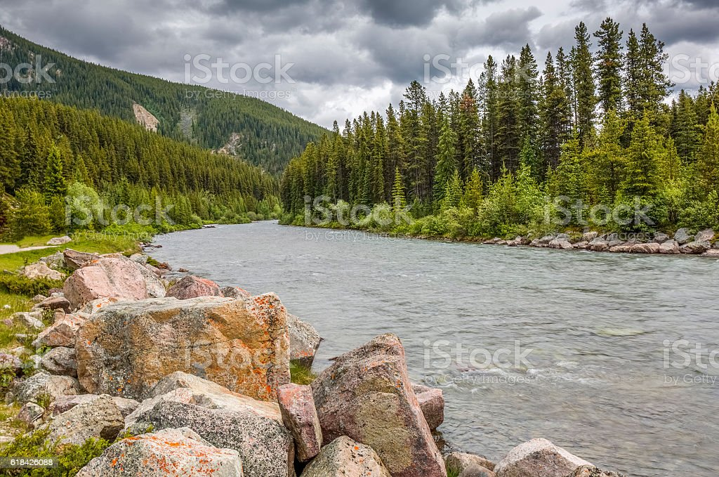 Granite Boulders Lining a Mountain River - Alberta, Canada stock photo