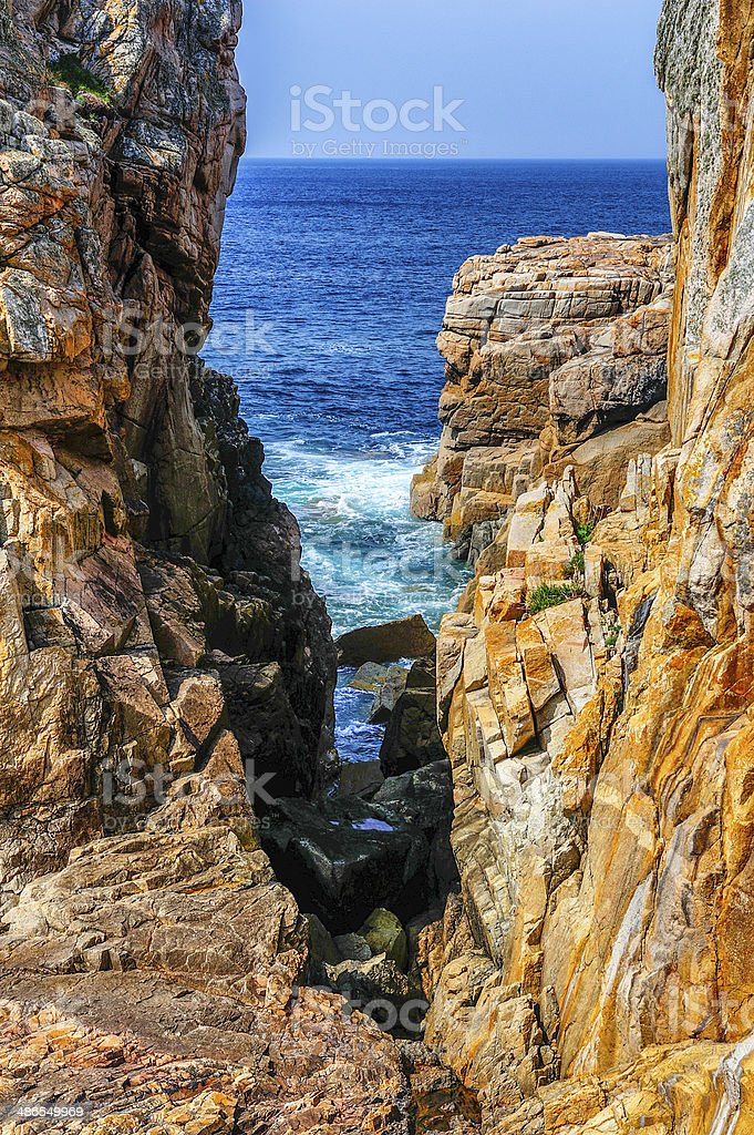 Granite boulders on shoreline in Brittany, France stock photo