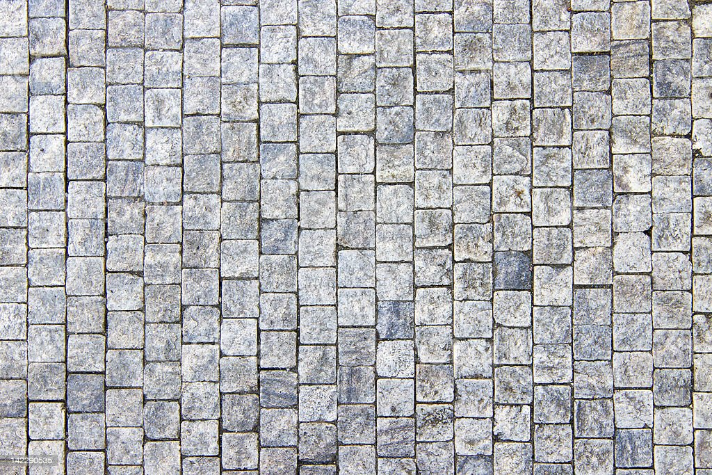 Granite cobblestoned pavement background royalty-free stock photo