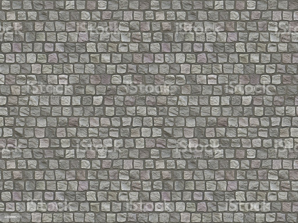 Granite cobblestoned pavement background. stock photo