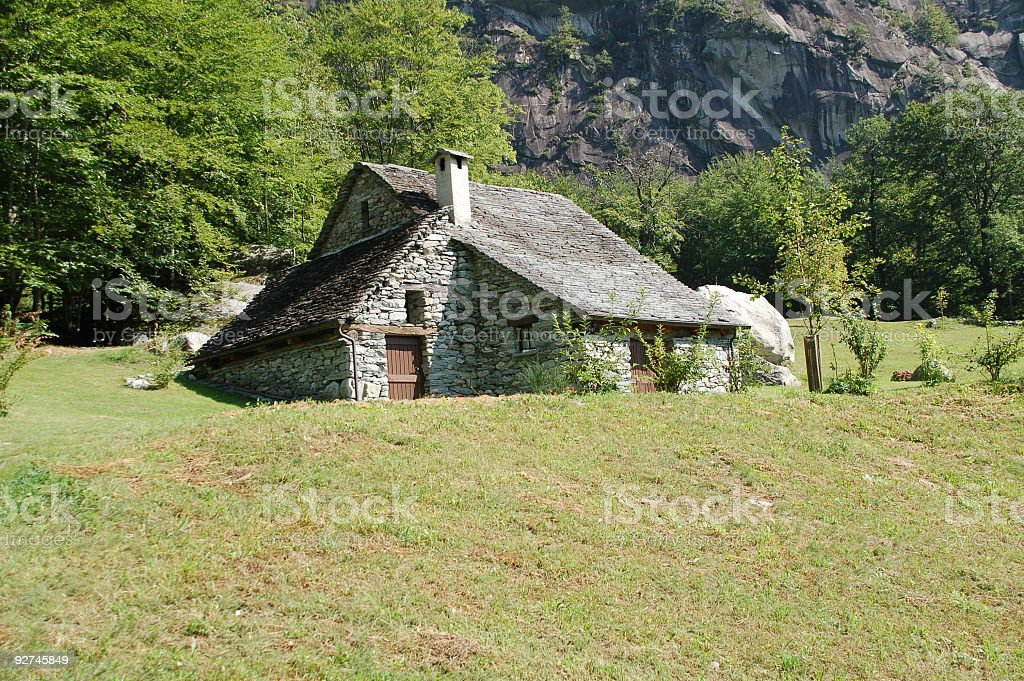 Granite Cottage in the Alps royalty-free stock photo
