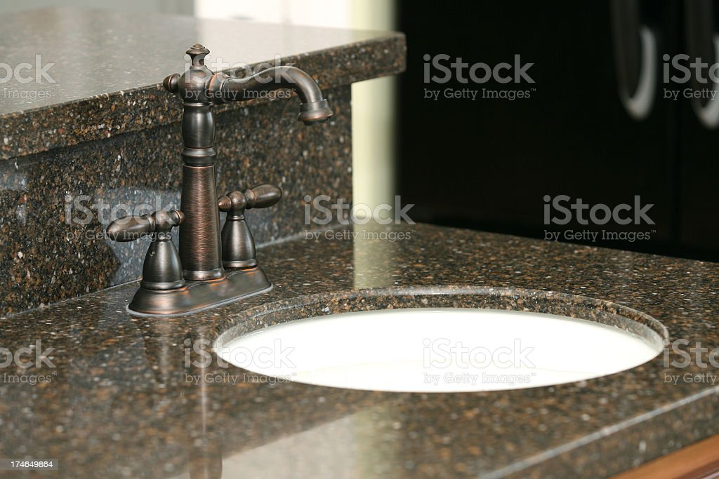 Granite counter and sink in bathroom stock photo
