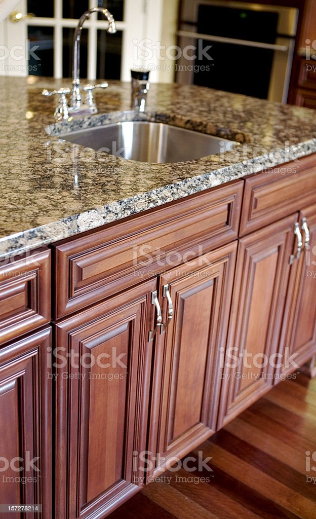 Granite Countertops in Modern Kitchen with Cherry Cabinets and...