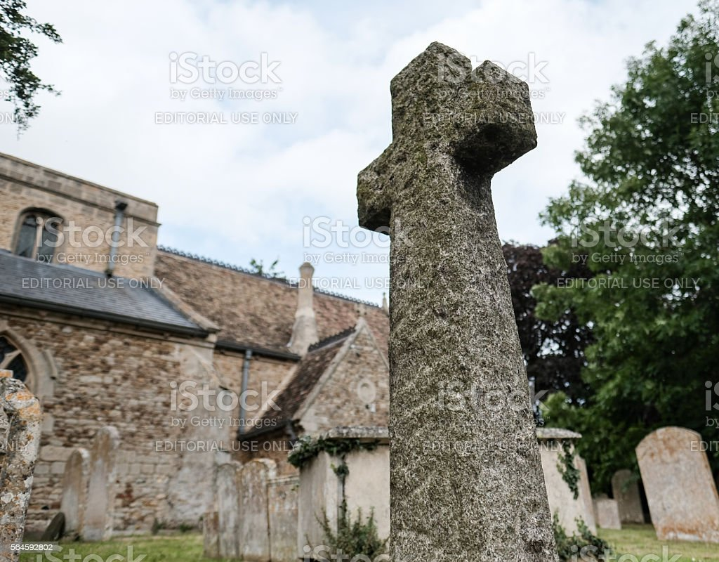 Granite Crucifix Headstone as seen in a cemetery stock photo