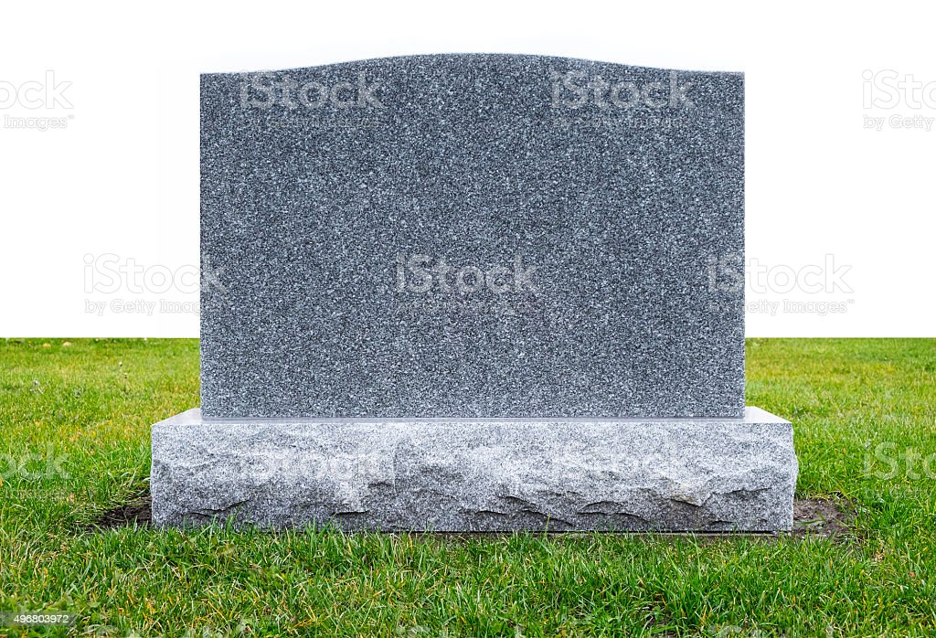 Granite Monument Stone on Green Grass stock photo