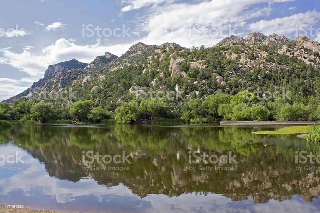 Granite Mountain Reflected in Lake stock photo
