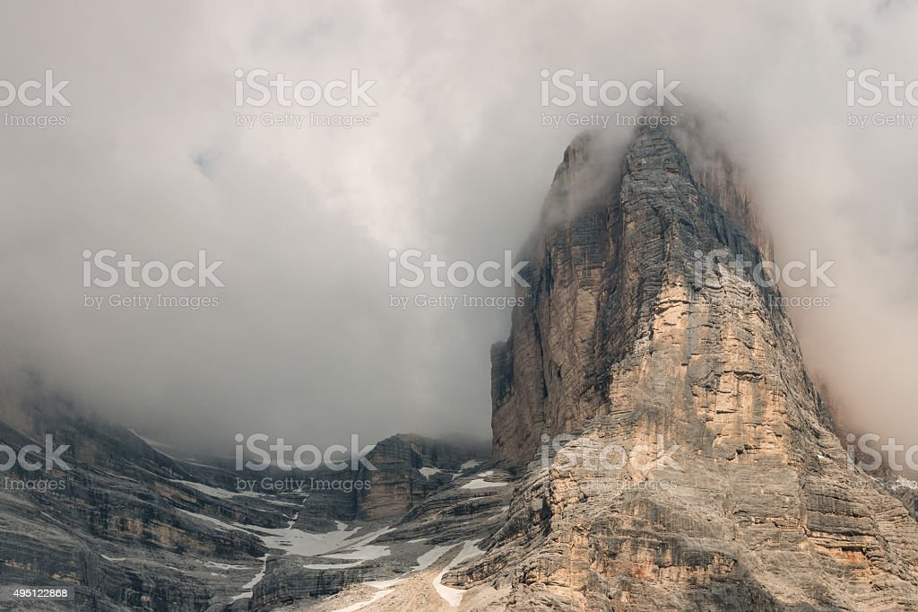 granite peaks obscured by clouds stock photo