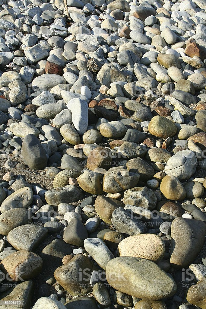 Granite pebbles, rounded by the ocean stock photo