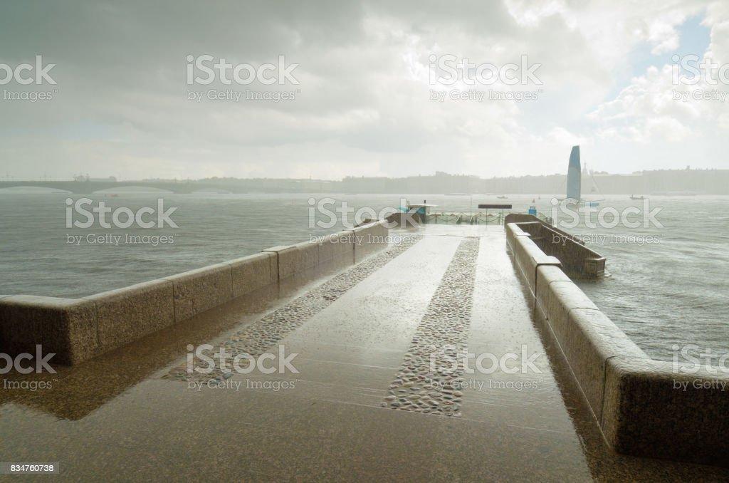Granite pier on the river. stock photo
