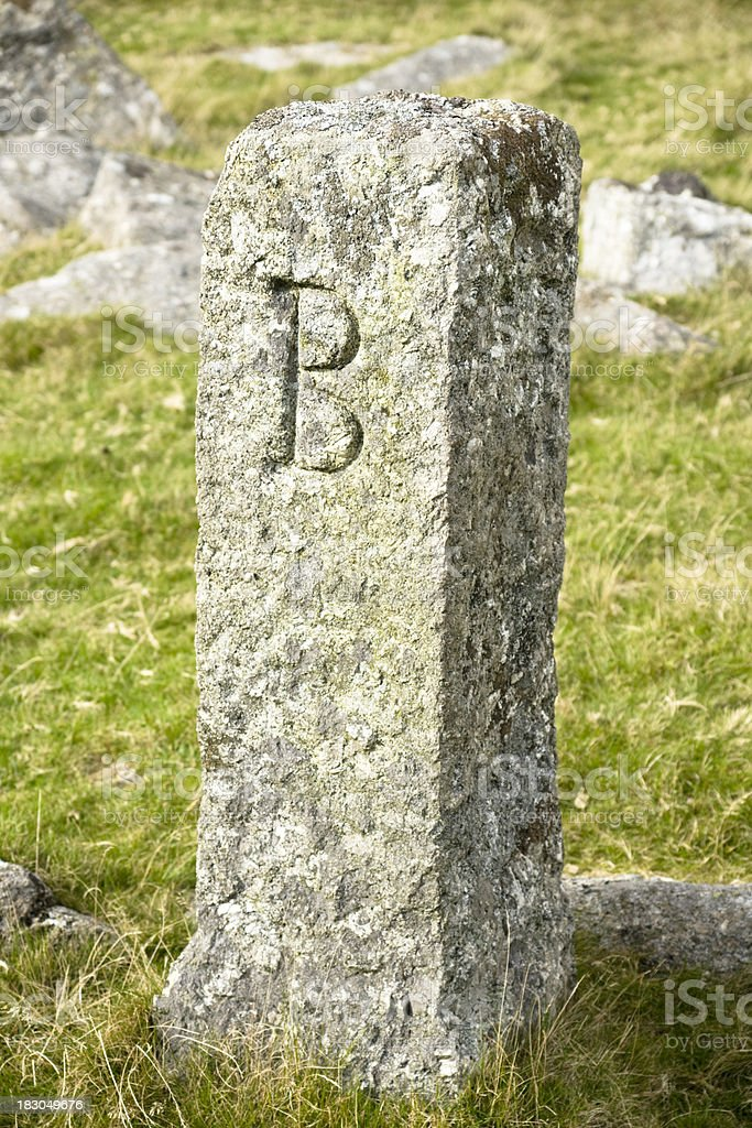 Granite post on Dartmoor with letter B royalty-free stock photo