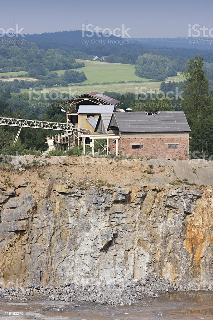 Granite quarry mining in the background industrial building stock photo