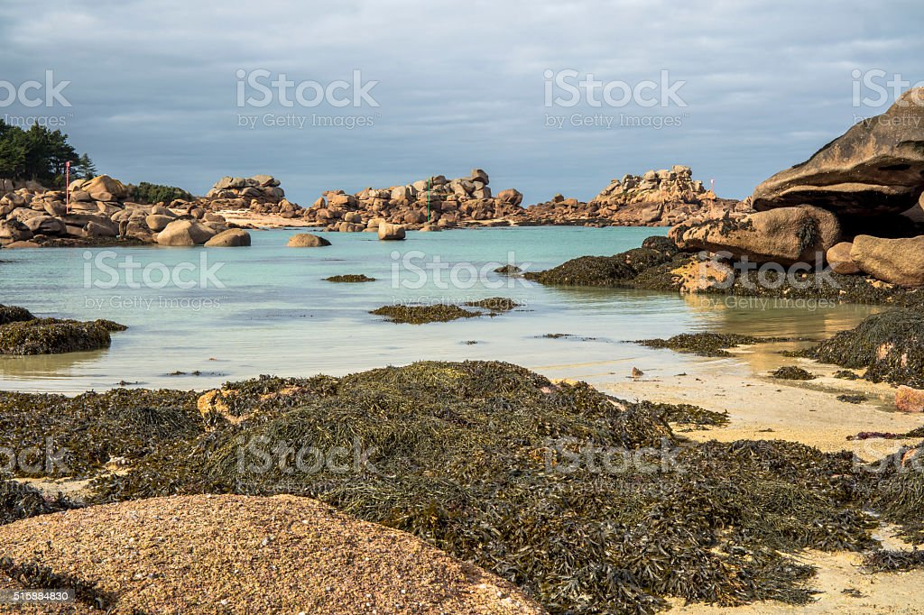 granite rocks on a beach stock photo