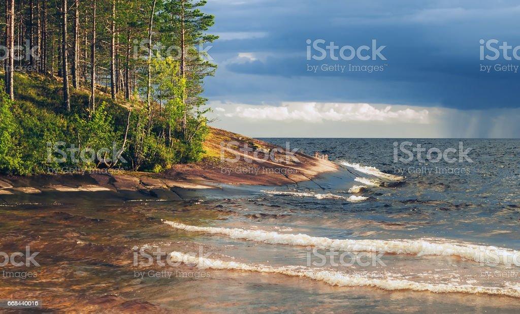 Granite Shore Of Lake Before The Storm stock photo