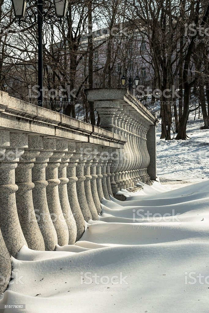 Granite stair railing in winter city park stock photo
