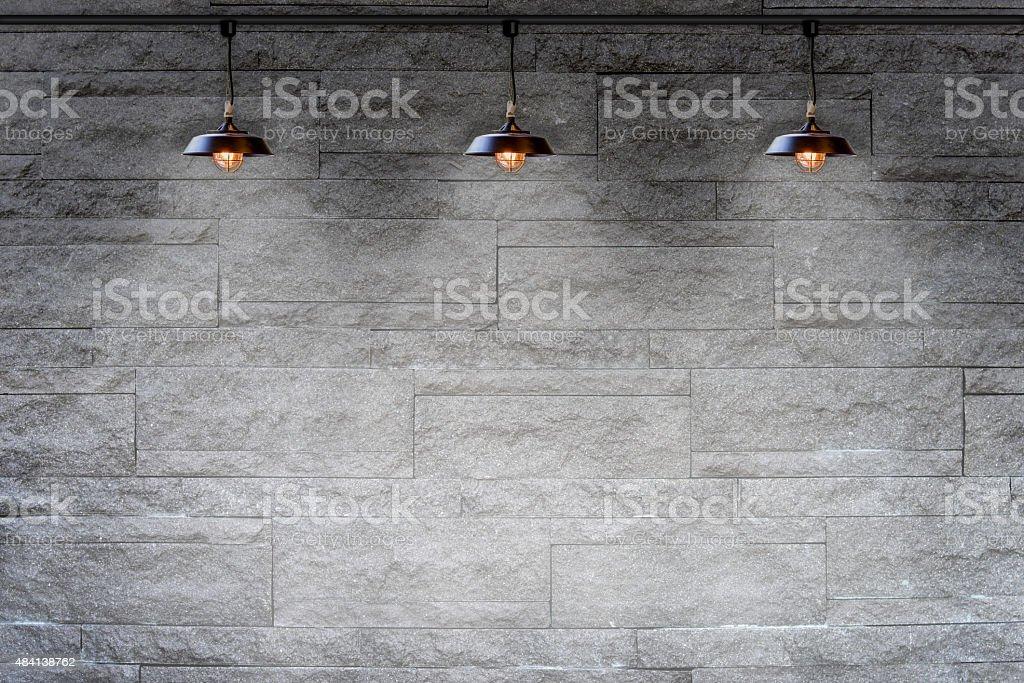 Granite stone decorative brick wall with lamp stock photo