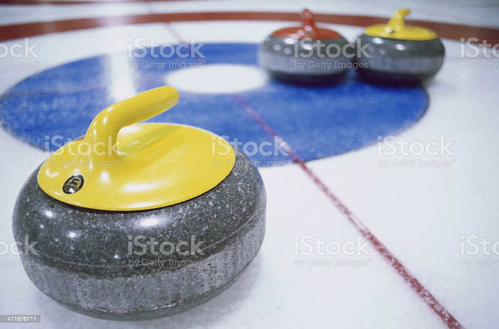 Granite stones for curling game on the ice stock photo