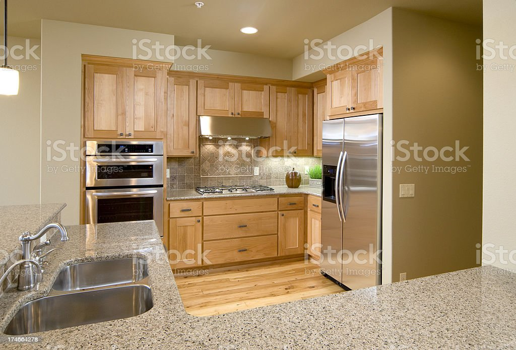Granite top counter, kitchen, with stainless steel appliances royalty-free stock photo