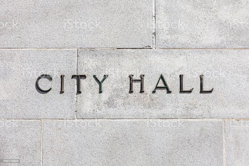 Granite Wall CIty Hall Sign stock photo