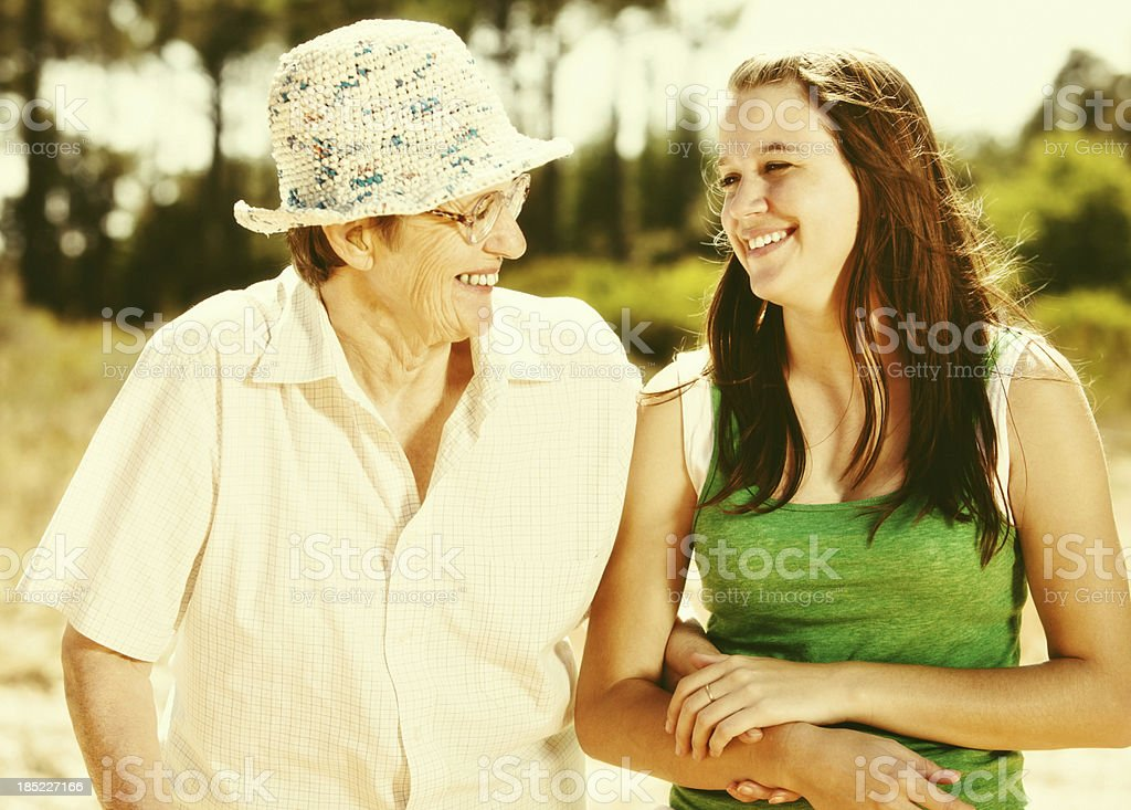 Granny and granddaughter share a moment of laughter in forest royalty-free stock photo