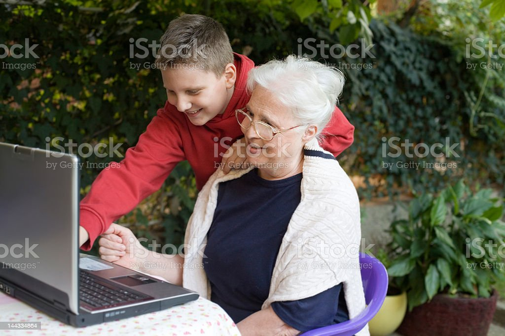 granny and grandson stock photo