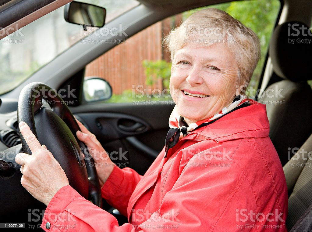 Granny in a car stock photo
