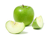 Granny Smith Apple and two apple wedges on white background