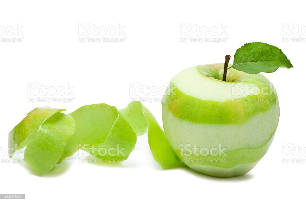 Granny Smith apple peeled in a swirl stock photo
