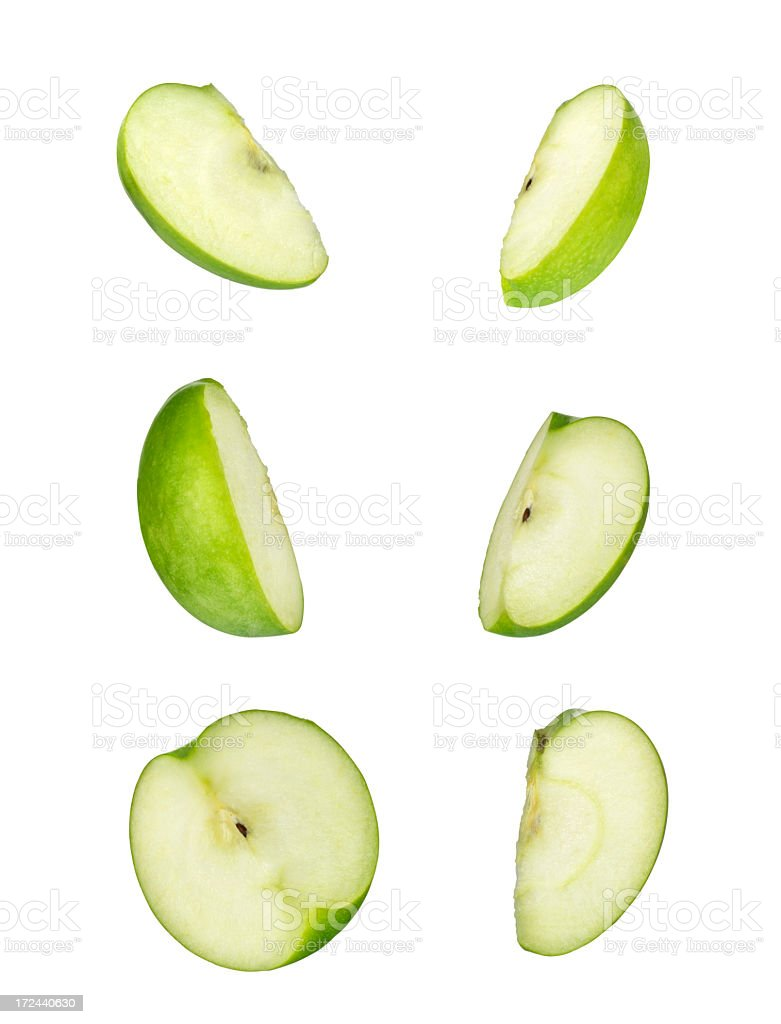 Granny Smith apple slices with seeds stock photo
