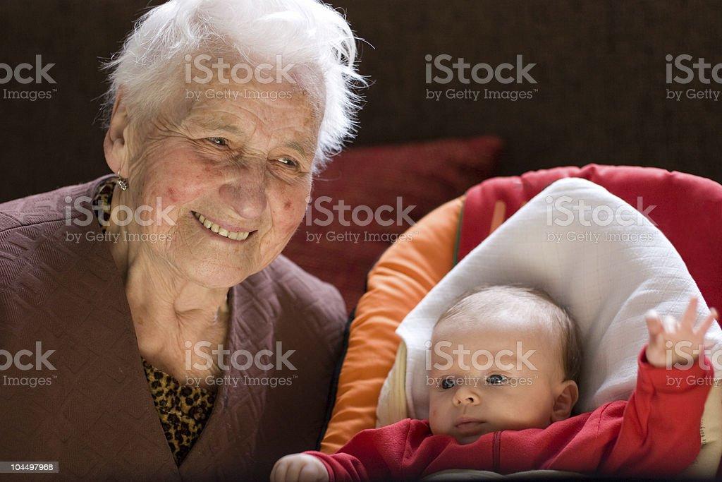 Granny with baby stock photo