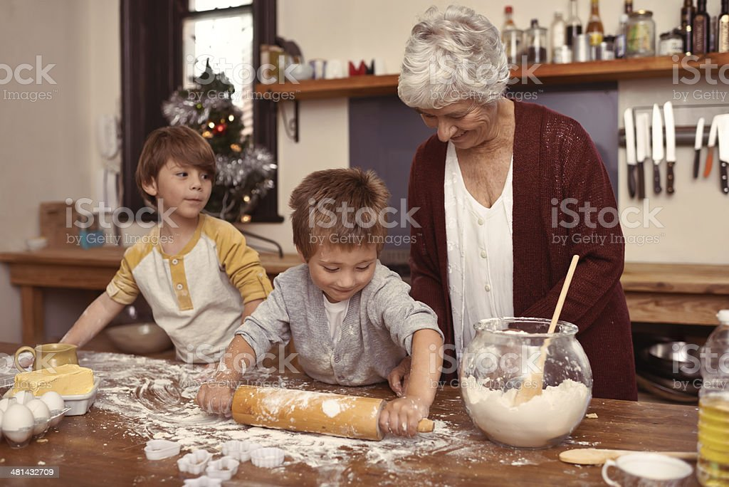 Granny's little bakers! stock photo