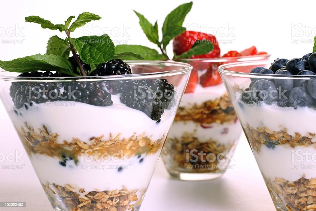 Granola and yogurt parfait with fresh berries stock photo