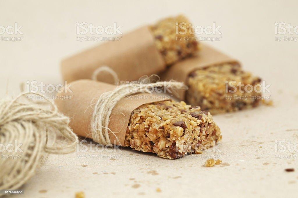 Granola bar or flapjacks on baking paper with hemp string stock photo