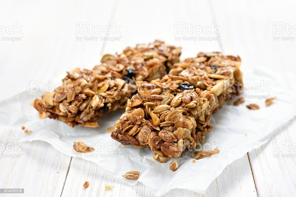 Granola bars on baking paper stock photo