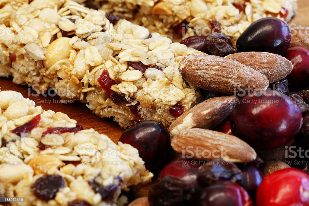 Granola Bars with Cranberries, Almonds and Raisins on Wood royalty-free stock photo
