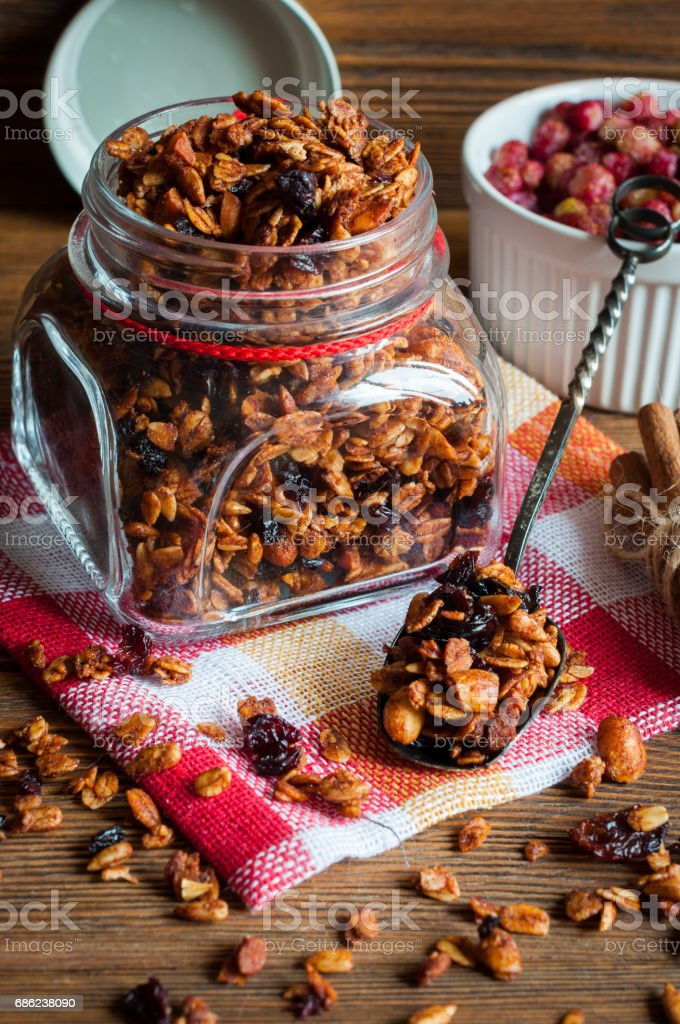 Granola in glass jar on rustic background stock photo