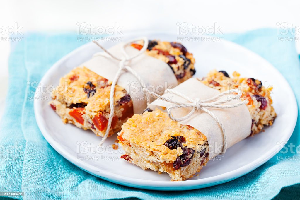 Granola, oatmeal, oat bars with dried cranberry Healthy breakfast stock photo