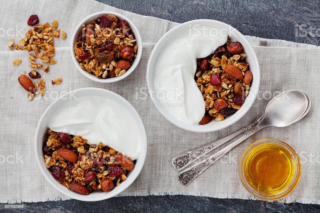 Granola or muesli with yogurt, healthy and diet breakfast stock photo