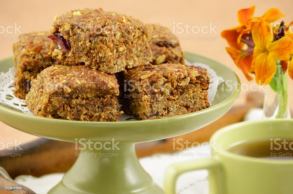 Granola squares on a green sigh for a healthy snack royalty-free stock photo