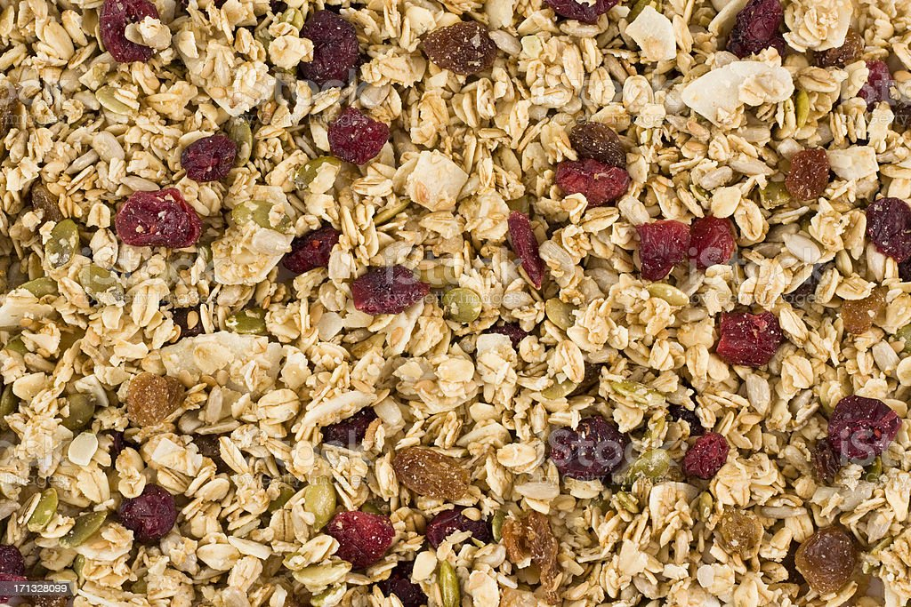 Granola with clusters of wholegrain oats seeds and dried berries stock photo
