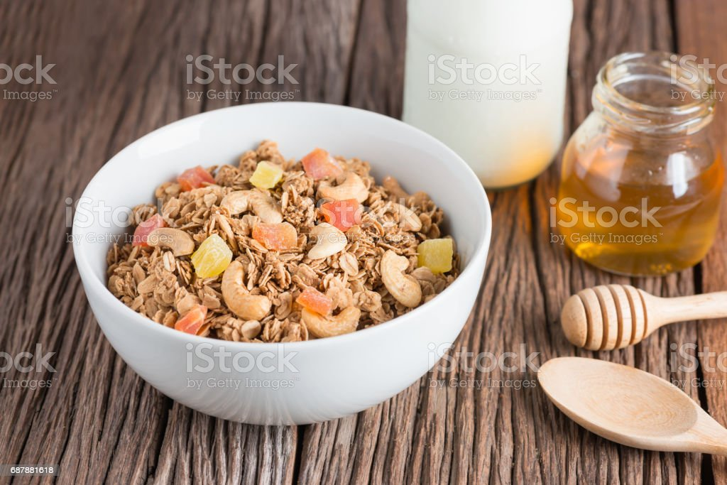 Granola with dried fruits and nuts in white bowl. stock photo