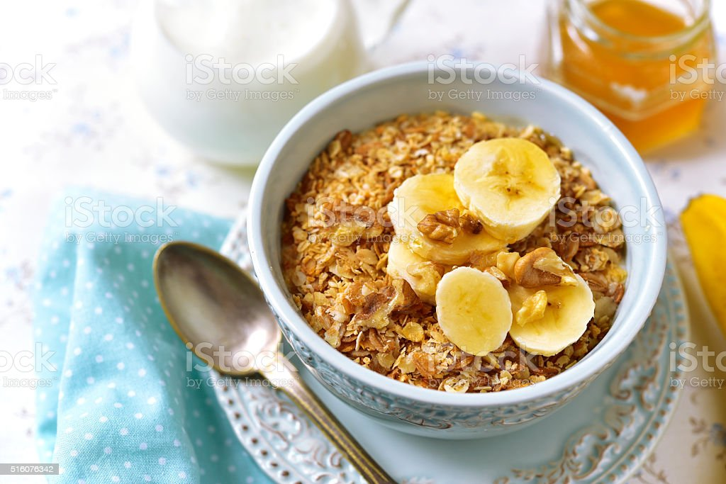 Granola with milk and banana slices. stock photo